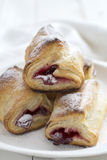 Puff Pastry Cherry Turnovers on desk Stock Images