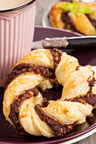 Puff pastry with chocolate. On a plate with coffee Stock Photos