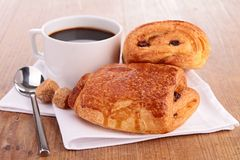 Puff pastry and coffee cup. On wood Royalty Free Stock Photos