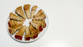 Puff pastry cone. Finger food Stock Photos