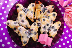 Puff pastry cookies with blueberry in butterfly shape Stock Image