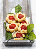 Puff pastry cookies filled with fresh strawberries Stock Photography