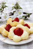 Puff pastry cookies in flower shape filled with strawberries Royalty Free Stock Image