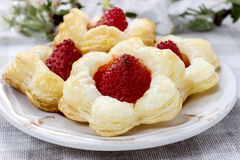 Puff pastry cookies in flower shape filled with strawberries Royalty Free Stock Photography