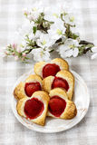 Puff pastry cookies in flower shape filled with strawberries Royalty Free Stock Photo