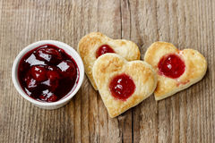 Puff pastry cookies in heart shape filled with cherries Royalty Free Stock Image