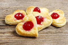 Puff pastry cookies in heart shape filled with cherries Royalty Free Stock Photos