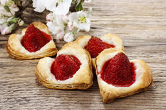 Puff pastry cookies in heart shape filled with strawberries Stock Photography