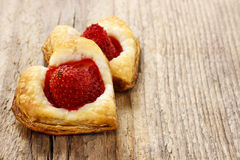Puff pastry cookies in heart shape filled with strawberries Royalty Free Stock Photography