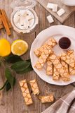 Puff pastry cookies. Puff pastry cookies with jam on white dish stock photos