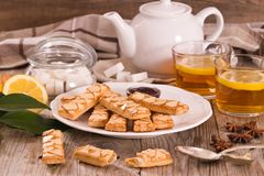 Puff pastry cookies. Puff pastry cookies with jam on white dish stock image