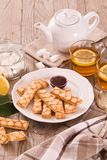 Puff pastry cookies. Puff pastry cookies with jam on white dish royalty free stock images