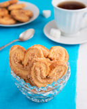 Puff pastry cookies in vase. On table Stock Image