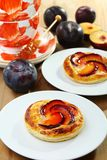 Puff pastry with cream  and plums. Royalty Free Stock Images