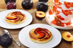 Puff pastry with cream  and plums. Royalty Free Stock Photography