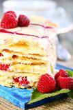 Puff pastry with cream and raspberries. Royalty Free Stock Photos