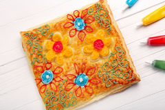 Puff pastry decorated with paintings Stock Images