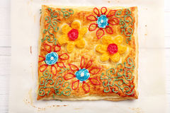 Puff pastry decorated with paintings Royalty Free Stock Photography