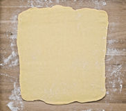 Puff pastry dough on baking board Royalty Free Stock Image