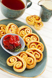 Puff pastry ears with sun-dried tomatoes stock images