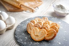 Puff pastry eyelet on slate Board, sprinkled with powdered sugar or flour.  royalty free stock image