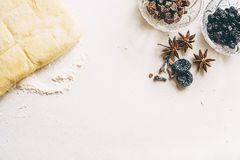 Puff pastry, flour, chopped chocolate and berries in two cups. Puff pastry, flour, chocolate and berries in two cups on white desk with copy space for text royalty free stock image