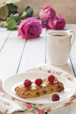 Puff pastry with fresh raspberries. And  a cup of tea Royalty Free Stock Photo