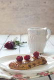 Puff pastry with fresh raspberries. And  a cup of tea Royalty Free Stock Photos