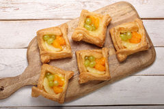 Puff pastry with fruits on a wooden background Royalty Free Stock Images