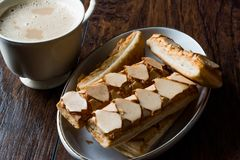 Puff Pastry Glazed Italian Biscuits with Cappuccino Coffee / Sfogliatine. Royalty Free Stock Photography