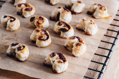 Puff pastry heart cookies on a baking paper Stock Image