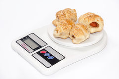 Puff pastry with hot dog on the digital scale Royalty Free Stock Photo