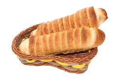 Puff pastry with a hot dog in a wicker basket Stock Image