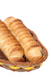 Puff pastry with a hot dog in a wicker basket Stock Images