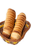 Puff pastry with a hot dog in a wicker basket Royalty Free Stock Photography