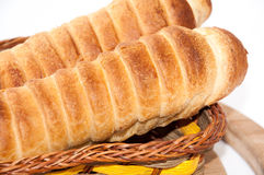 Puff pastry with a hot dog in a wicker basket Stock Photos
