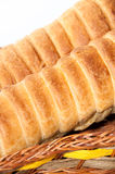 Puff pastry with a hot dog in a wicker basket Stock Photography