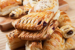 Puff pastry with jam filling. Puff pastry with sweet cream filling, selective focus Royalty Free Stock Images