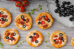 Puff pastry mini pizza royalty free stock photos