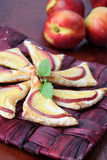 Puff pastry with nectarines Royalty Free Stock Images