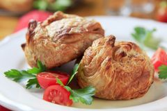 Puff pastry parcels. Stuffed with savory filling royalty free stock photos