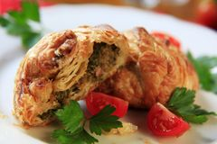 Puff pastry parcels. Stuffed with savory filling royalty free stock photo