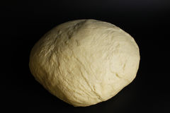 Puff pastry for a pie. On the black Stock Photography