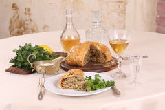 Puff pastry pie with chicken and mushrooms, kórnik. Puff pastry pie with chicken and mushrooms and the brandy in the glass stock image