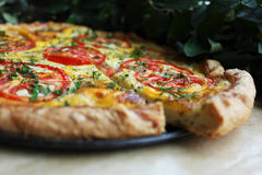 Puff pastry pie with curd cheese, tomatoes, cheese and herbs Stock Photos