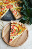 Puff pastry pie with curd cheese, tomatoes, cheese and herbs Stock Photo