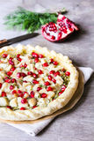 Puff pastry pie with fish cod fillet, spinach, dill, pomegranate seeds and cream cheese Royalty Free Stock Photo