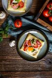 Puff pastry pies with egg, bacon, mushrooms and tomato. Savory puff pastry pies with egg, bacon, mushrooms and tomato stock images