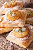 Puff pastry pies with pineapple, decorated with mint close up. v Stock Image