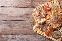 Puff pastry pies with red onions and tomatoes Horizontal top vie Royalty Free Stock Image
